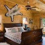 Animal skins and a sleigh bed and give a feeling of luxury to the guest room, which features a separate full bath and private balcony.