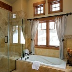 Custom touches in the master bath include a jetted tub, heated tile flooring and oil-rubbed bronze faucets.