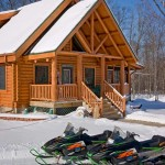 The couple, both of whom are log home dealers, chose a different log profile from the house (a double- tongue-and-groove D-shaped log with a saddle-notched corner system) to give clients a sample of the range of possibilities.