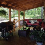 A roomy porch is a favorite place for the Smiths to take full advantage of the home's wooded setting at the foot of a mountain.