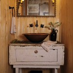 The patina of age lends unmistakable vérité; a new copper vessel sink, placed atop a weathered piece of furniture and fed via wall-mounted handles and spigot, is paired with a Tramp Art mirror in the tiny powder room.