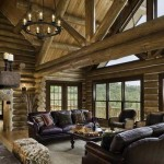The magnificent great room showcases the greatness of the log-home lifestyle. From the gargantuan, hand-scribed Norway pine beams above to the sweeping views beyond, the space offers earthy elegance at every turn.