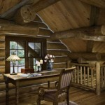 "Sleek, simple furniture enhances the handsome pine and chinking in the loft. Weighty, hand-scribed logs add snugness and visual impact, as well as the serious ""wow"" factor that makes falling in love with log homes so easy."