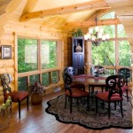 The dining room is one of the few rooms in the home that was not designed around the couple's existing furnishings, and one of the family's favorite spots because they feel as if they're floating amid the trees.