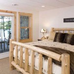 """A guest bedroom in the lower level leads to a patio outfitted with two rocking chairs and a table. """"It's a place with a beautiful view where our guests can have their coffee in the morning,"""" Rocky says."""