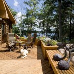 Rocky designed the expansive deck off the kitchen to incorporate flower boxes that double as boundaries. The deck also serves as the starting point for a waterfall that ends near the lower-level patio and fire pit.