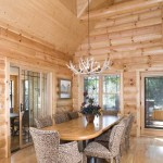 To soften the visual impact of the log walls, hardwood floors and burled oak table, Gil and Rocky upholstered the chairs in the dining area, which borders the great room, kitchen and sunroom.