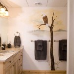 In several spaces throughout the home — including the guest bathroom on the lower level — Rocky commissioned an artist to paint nature-inspired murals, such as this eagle perched atop a tree.