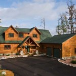 Built by Tomahawk Log & Country Homes using traditional stick-framing, this vacation residence in north central Wisconsin features hand-hewn half-log pine siding and log accents throughout the interior.
