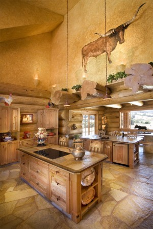 The kitchen features two islands and a faux-painted plaster wall.