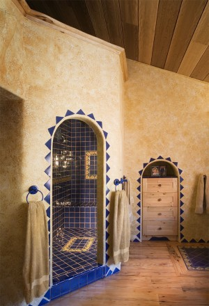 Blue ceramic tile brightens the master bath.