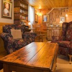 Each family area in the cabin has a designated activity, with the basement living area reserved as a TV room. Also included on the lower level are a guest bedroom and modern bathroom.