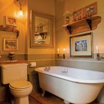 An antique clawfoot soaking tub flanked by natural candlelight provides ultimate relaxation. The narrower wood planks installed in the upper level were fabricated to recreate the look of the original flooring, which has been reinstalled in the main level.
