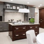 Rich classics -- from the warm gray cabinetry to the deep walnut island -- get a contemporary upgrade in the kitchen through reflective white mother-of-pearl-inspired surfaces.