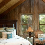 Two bedrooms, one for guests and one for the kids, flank the upper level of the home, with an open loft in between. To add visual interest to the guest bedroom, as well as texture to the logs, the Polowniaks incorporated barn siding on the walls.