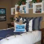Bolder colors and images of ocean sports add coastal flair to this boy's bedroom. Nautical touches, such as the grommeted rope comforter, infuse more of a masculine flavor into the space.