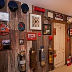 Mel's upper-level office is paneled in salvaged barn board and decorated with the tools of his trade. He's worked as both a fire-department trainer and in the state fire marshal's office.