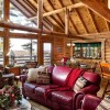 """This cabin design has a 24-foot-wide prow front extending 4 feet beyond the standard corners of the building,"" states Bryan Kerby, president of Northwoods Log Homes. The great room is designed with two 24-foot cross-ties within the exposed structural roof system."