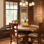 The informal dining room features a table that builder Greg Lee built of reclaimed oak, along with a weathered chest that Mikki purchased at a flea market in nearby Kalispell. Mikki's mother drew the picture on the wall.