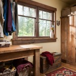 Builder Greg Lee paid attention to detail in the cabin, even in the most utilitarian of areas. In the laundry room, he crafted a laundry table from the reclaimed barn wood, along with a cabinet that houses the mechanicals.