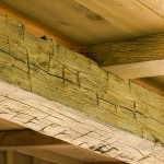 Hand-hewn oak beams contribute to the cabin's rustic look.
