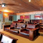 "Because a theater room is separate from the rest of the cabin, you can let your personality show with an over-the-top design theme. ""It can be anything for car racing memorabilia to Western movies,"" says designer Allen Halcomb. ""The key is to keep it fun."" Credit: MossCreek Designs photo"