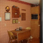The kitchen's original red-and-tan checkered wallpaper did not suite the Foersters' taste.