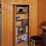 A hidden bookcase door in the bunkroom leads to the Andersons' next project: a wine room.