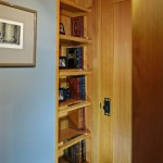 The short hallway leading to the master bedroom features a built-in bookcase/ladder that leads to a carpeted loft where the grandchildren can play. The ladder has oak rungs for added strength.