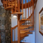 Spiral stairs are great for small spaces, says John. The architect originally wanted an iron staircase, but John suggested laminated fir to complement the rest of the home.