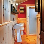"""The full bath features all the amenities one would expect to find in a modern cabin, such as a shower and flushable toilet. Although Gregg and his brothers frequently use the cabin for hunting trips, Sharon and her friends occasionally spend girls' shopping weekends there as well. """"We weren't going to use it until there was a working bathroom, though,"""" she notes."""