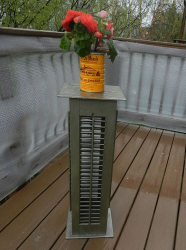Our finished plant stand, complete with a coffee can-turned-flower pot, took about six hours total to create.