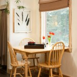 Off the kitchen is a bright breakfast nook with a generously sized window for light and warmth.