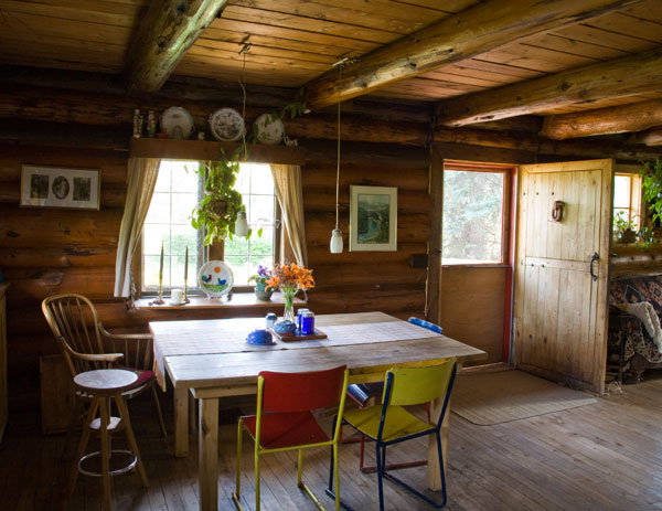 "The Ewerts relied only on local, natural materials to build and maintain their two-story three-bedroom cabin. ""We like the look of old-fashioned oiled logs, and we didn't want to use any chemical preservatives,"" Linda says. ""We just wipe them down with linseed oil every year."""
