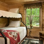 Designed with overnight guests in mind, the cabin's two guest bedrooms can easily sleep two apiece. Just beyond the windows, the foothills of the White Mountains beckon.