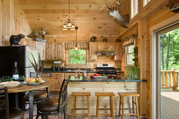 "Lisa's favorite part of the cabin, the modest but fully functional kitchen, is just the right size for the family — and for cooking and serving the many animals John and Spencer bag. ""We harvest everything we hunt,"" says John. ""Nothing goes to waste."""