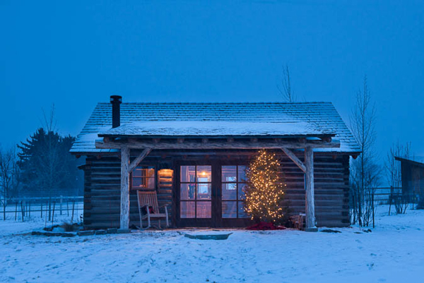The little bunkhouse gets in the spirit with a simple outdoor tannenbaum lit with tiny white lights.