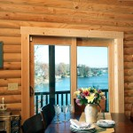 A sliding door provides direct access from the dining room to the wraparound porch, with a perfect view of the lake below.