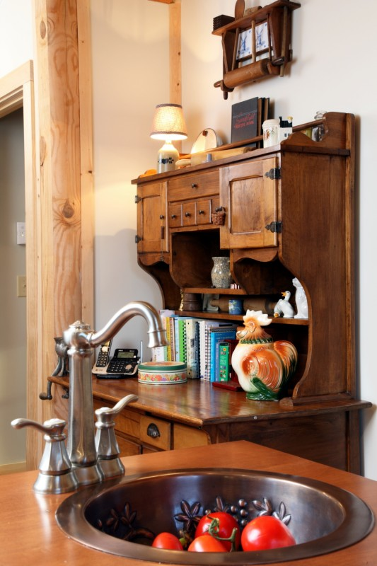 A secondary sink adds additional prep space to the country-style kitchen.