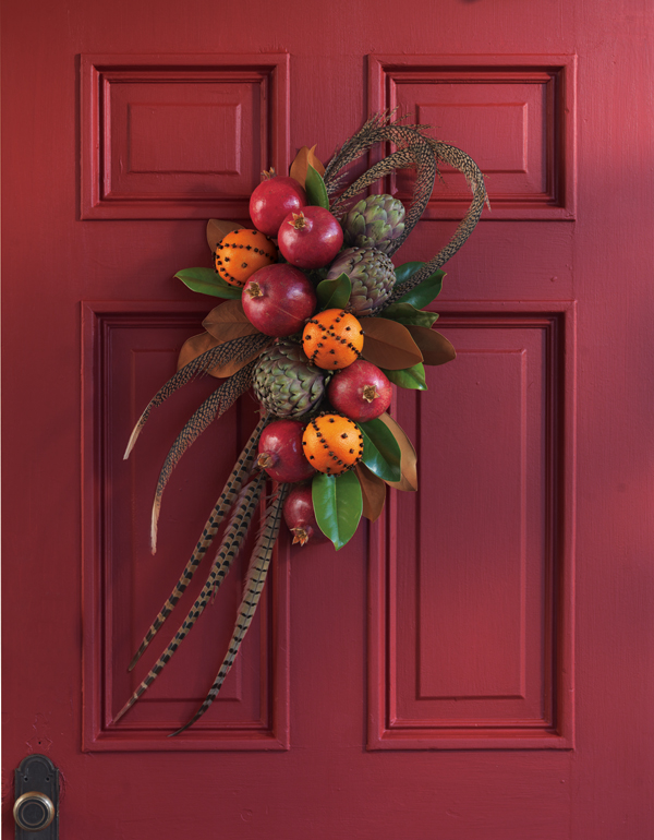 Various fruits, including shiny pomegranates, provide a mixture of color and texture for an eye-catching holiday wreath. Courtesy of POM wonderful