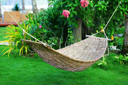 Hammocks are a traditional outdoor relaxation method. Credit: fotolia.com/EkaterinaPokrovsky photo