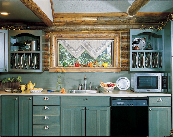 An L-shaped configuration and a fresh coat of cool country green paint, with open cabinetry to boot, allow this small kitchen to live large within its compact design.