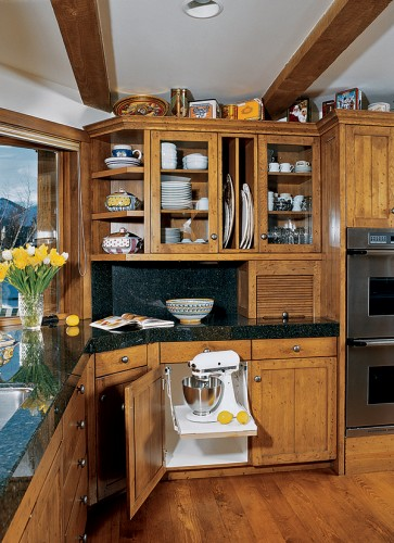 Slide-out shelves are perfect for storing small appliances that aren't subject to everyday use. Lazy Susans are another great solution to optimize corner cabinet space.
