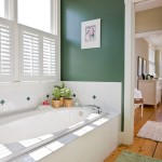 Shutters provide necessary privacy for the master bathroom while still allowing in plenty of natural light.