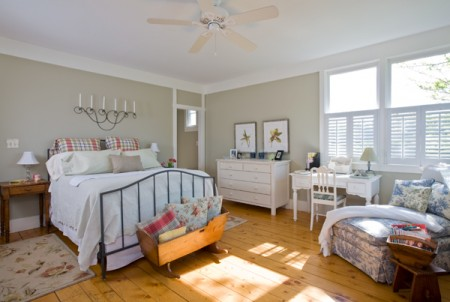 The master bedroom is situated on the eastern side of the home to capture the early morning sun. The shutters are one of the few sets of window treatments in the house to allow as much natural light into the home as possible. Mary loves the coloring and influx of sunshine here.