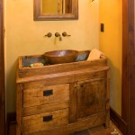In addition to the well-worn appearance they shought for the exterior, the Rotes are avid antique collectors and sought to infuse many of those elements in the interior as well. Here, a copper basin was fashioned among an antique chest to create a unique vanity.