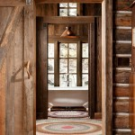 A salvaged wood door between the main cabin and the addition allow the sleeping area to be closed off. A half wall and pocket door provide added privacy in the bathroom.