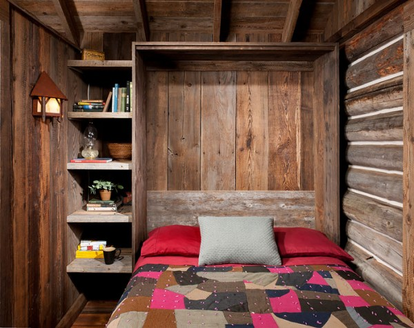 """The rear addition allowed for a small bathroom and a sleeping area complete with a foldable Murphy bed. """"It enabled the main room to be this great little fireplace living room,"""" says the architect."""
