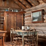 John and his wife didn't feel pressure to furnish the cabin in a hurry. Instead, they browsed antique shops for items such as this distressed kitchen table and armoire-turned-pantry.