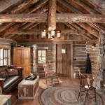 Homesteading cabins, like John's, often had short log stacks, which made the windows and door frames uncomfortably low. John and the architect added three stacks of logs to heighten the roof and install a row of windows behind the couch to let in more light.